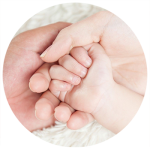 parents holding baby hands